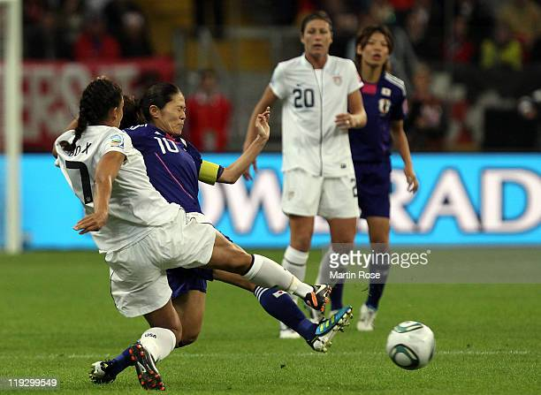 Homare Sawa of Japan and Shannon Boxx of USA battle for the ball during the FIFA Women's World Cup Final match between Japan and USA at the FIFA...
