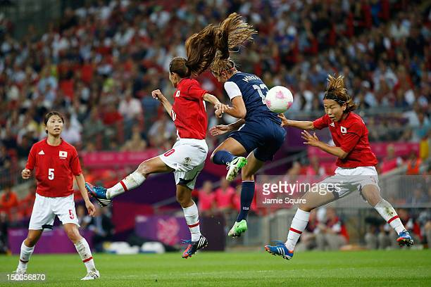 Homare Sawa of Japan battles for the ball with Alex Morgan of the United States during the Women's Football gold medal match on Day 13 of the London...