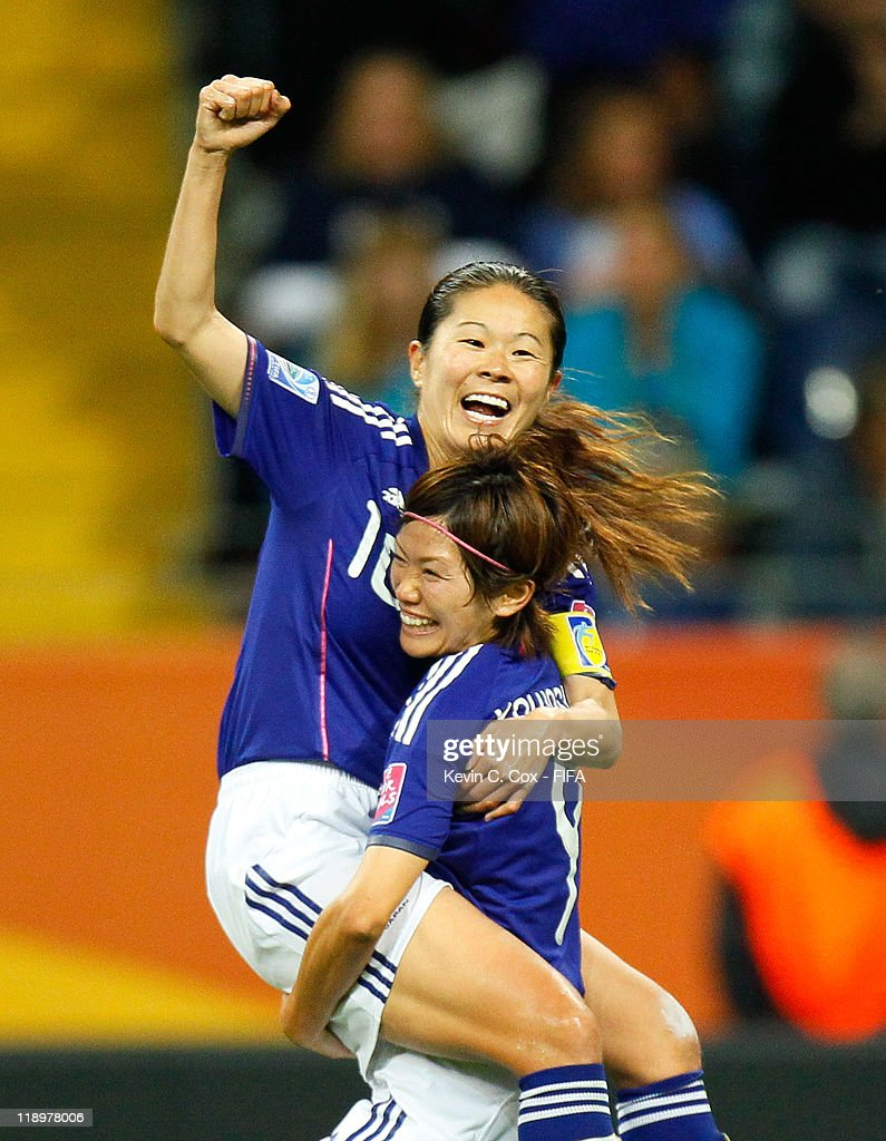 <a gi-track='captionPersonalityLinkClicked' href=/galleries/search?phrase=Homare+Sawa&family=editorial&specificpeople=744563 ng-click='$event.stopPropagation()'>Homare Sawa</a> of Japan celebrates her goal against Sweden with <a gi-track='captionPersonalityLinkClicked' href=/galleries/search?phrase=Nahomi+Kawasumi&family=editorial&specificpeople=7797300 ng-click='$event.stopPropagation()'>Nahomi Kawasumi</a> during the FIFA Women's World Cup Semi Final match between Japan and Sweden at the FIFA World Cup Stadium Frankfurt on July 13, 2011 in Frankfurt am Main, Germany.