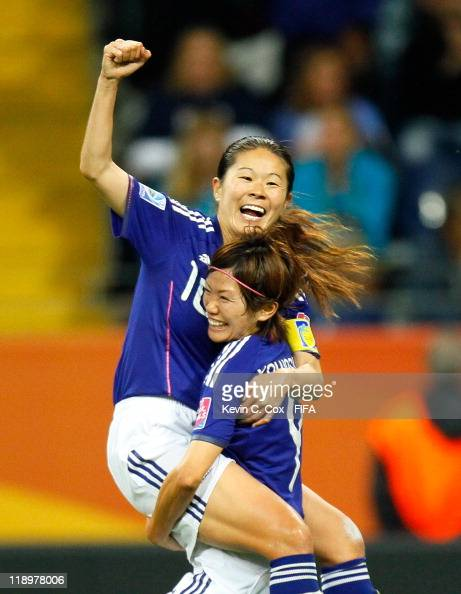 Homare Sawa of Japan celebrates her goal against Sweden with Nahomi Kawasumi during the FIFA Women's World Cup Semi Final match between Japan and...