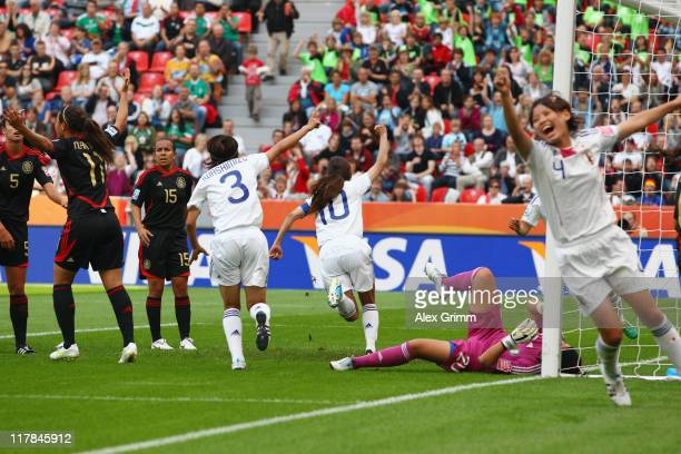 Homare Sawa of Japan celebrates her team's first goal during the FIFA Women's World Cup 2011 Group B match between Japan and Mexico at the Fifa...