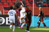 Homare Sawa of Japan celebrates her team's fourth goal with team mates Nahomi Kawasumi and Aya Sameshima during the FIFA Women's World Cup 2011 Group...