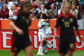 Homare Sawa of Japan celebrates her team's third goal with team mate Aya Miyama during the FIFA Women's World Cup 2011 Group B match between Japan...