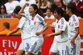 Homare Sawa of Japan celebrates her team's third goal with team mates during the FIFA Women's World Cup 2011 Group B match between Japan and Mexico...