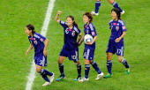 Homare Sawa of Japan celebrates scoring her team's second goal during the FIFA Womens's World Cup Final between the United States of America and...