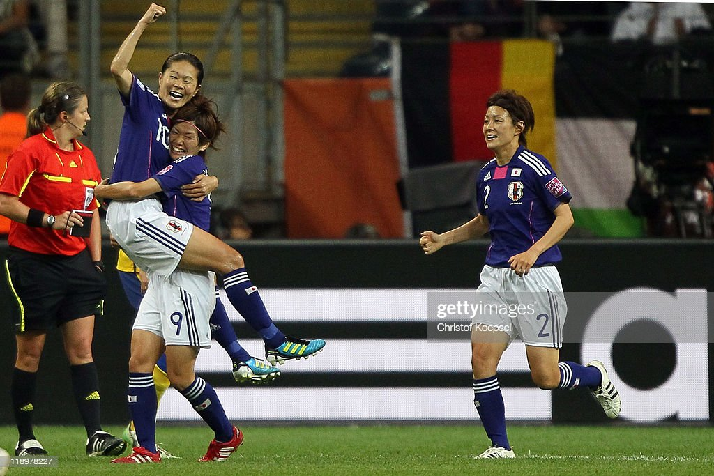 Homare Sawa of Japan (L) celebrates the second goal with Nahomi Kawasumi of Japan (R) during the FIFA Women's World Cup Semi Final match between Japan and Sweden at the FIFA World Cup stadium Frankfurt on July 13, 2011 in Frankfurt am Main, Germany.