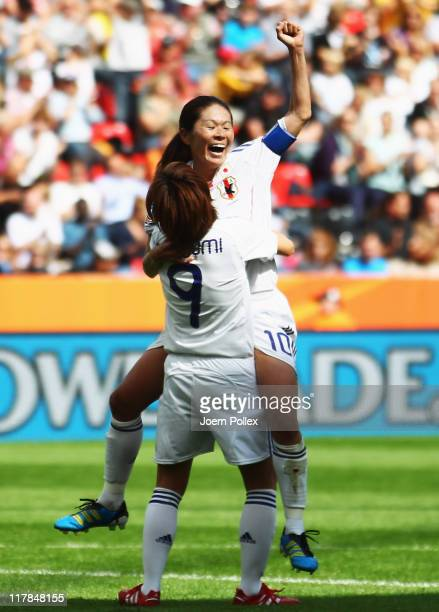 Homare Sawa of Japan celebrates with her team mate Nahomi Kawasumi after scoring her team's fourth goal during the FIFA Women's World Cup 2011 Group...