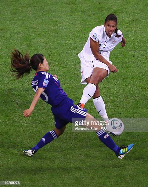Homare Sawa of Japan fights for the ball with Shannon Boxx of USA during the FIFA Women's World Cup Final match between Japan and USA at the FIFA...