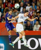 Homare Sawa of Japan goes up for a header against Abby Wambach of USA during the FIFA Women's World Cup Final match between Japan and USA at the FIFA...
