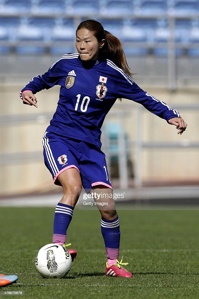 <a gi-track='captionPersonalityLinkClicked' href=/galleries/search?phrase=Homare+Sawa&family=editorial&specificpeople=744563 ng-click='$event.stopPropagation()'>Homare Sawa</a> of Japan in action during the Algarve Cup final match between Germany and Japan on March 12, 2014 in Faro, Portugal.