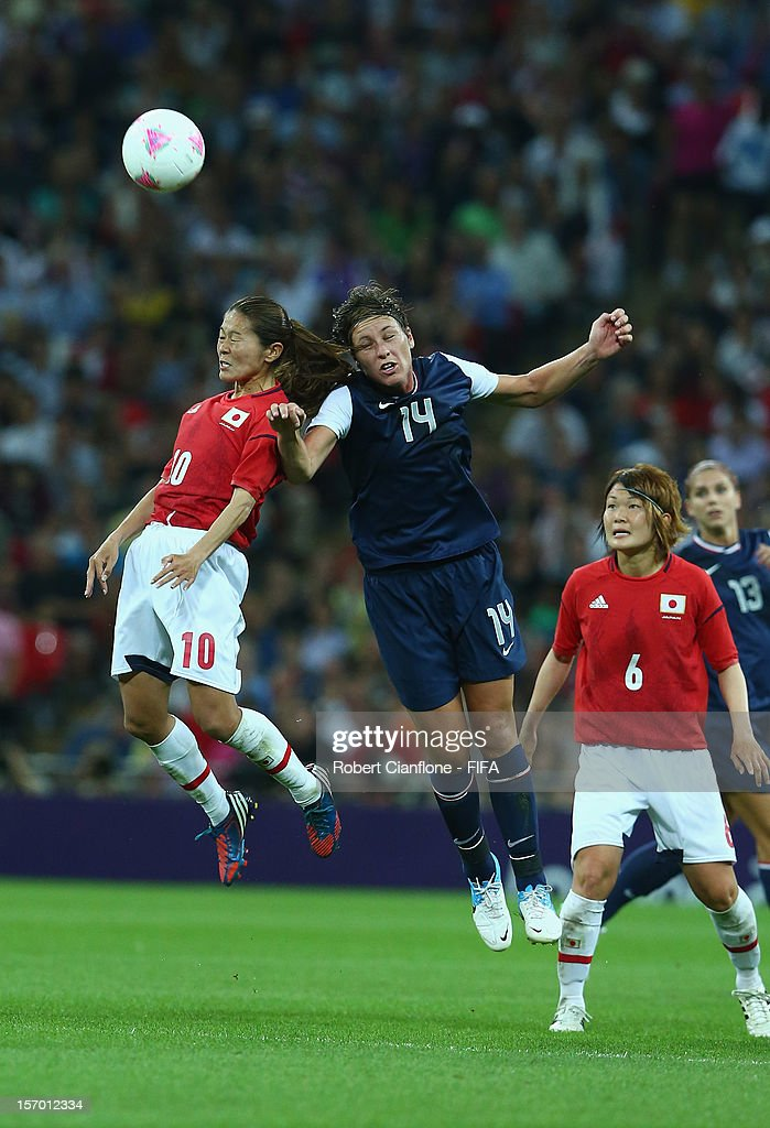 Homare Sawa of Japan is challenged by Abby Wambach of the USA during the Women's Football Final match between the USA and Japan on Day 13 of the London 2012 Olympic Games at Wembley Stadium on August 9, 2012 in London, England.
