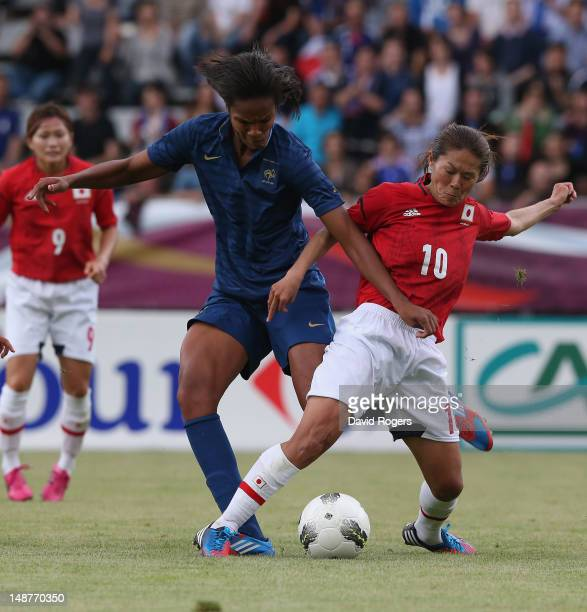 Homare Sawa of Japan is challenged by Wendie Renard during the friendly international match between Japan Women and France Women at Stade Charlety on...