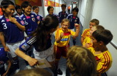 Homare Sawa of Japan jokes with the escort kids prior to the FIFA Women's World Cup Semi Final match between Japan and Sweden at the FIFA World Cup...