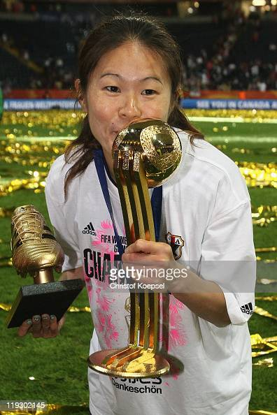 Homare Sawa of Japan kisses the trophy after weinning 53 after penalty shootout the FIFA Women's World Cup Final match between Japan and USA at the...