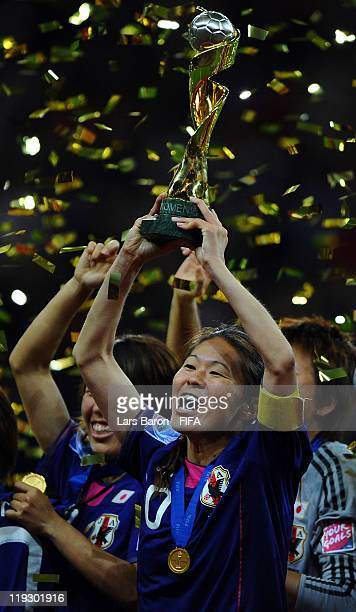 Homare Sawa of Japan lifts the trophy after winning the FIFA Women's World Cup Final match between Japan and USA at the FIFA Women's World Cup...