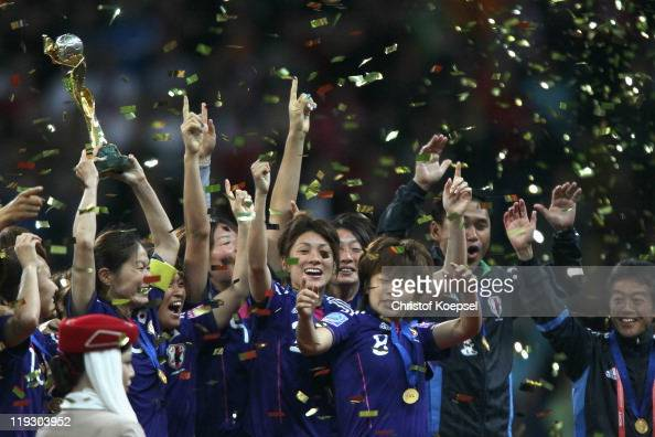 Homare Sawa of Japan lifts the winning trophy on the podium after winning 53 after penalyts shootout the FIFA Women's World Cup Final match between...