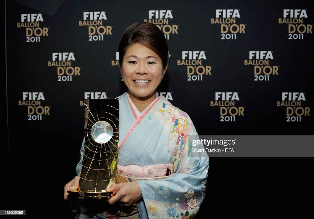 Homare Sawa of Japan poses with the trophy after winning the FIFA Women's World Player of the Year award at the FIFA Ballon d'Or Gala 2011 at the Kongresshaus on January 09, 2012 in Zurich, Switzerland.