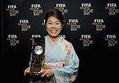 Homare Sawa of Japan poses with the trophy after winning the FIFA Women's World Player of the Year award at the FIFA Ballon d'Or Gala 2011 at the...