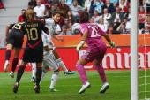 Homare Sawa of Japan scores her team's third goal against Luz del Rosario Saucedo Dinora Garza and goalkeeper Cecilia Santiago of Mexico during the...