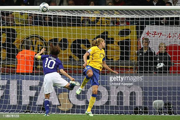 Homare Sawa of Japan scores the second goal against Charlotte Rohlin of Sweden during the FIFA Women's World Cup Semi Final match between Japan and...