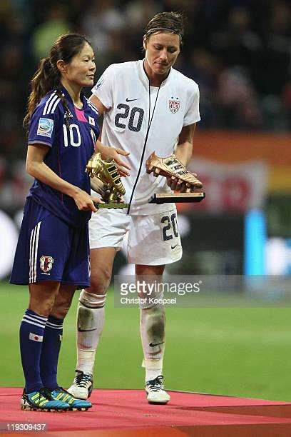 Homare Sawa of Japan winning the adidas golden shoe award as the best player of the tournament and Abby Wambach of USA winning the adidas silver...