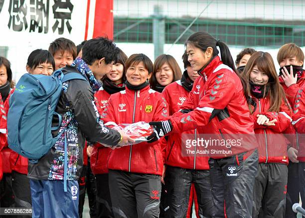 Homare Sawa presents gifts to a fan during the INAC Kobe Leonessa Fan Festival at the Kobe Ladies Football Center on January 30 2016 in Kobe Hyogo...