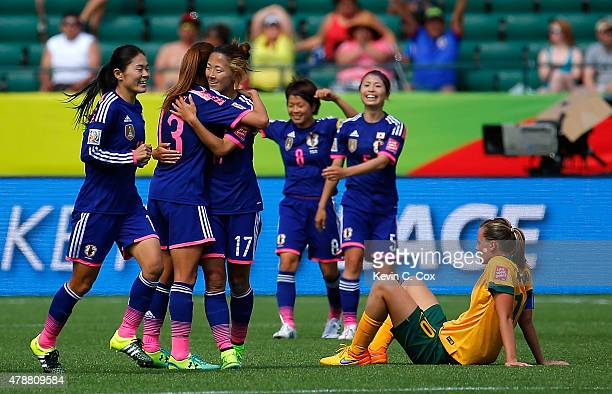 Homare Sawa Rumi Utsugi and Yuki Ogimi of Japan celebrate their 10 win over Australia in the FIFA Women's World Cup Canada 2015 Quarter Final match...