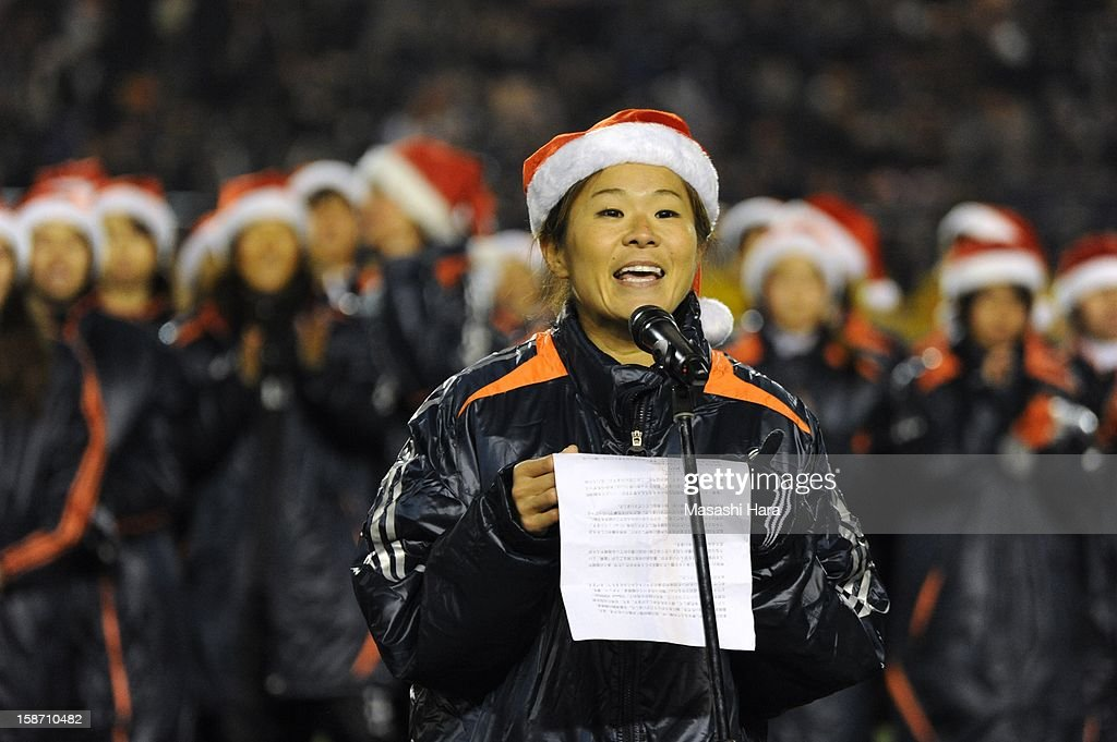 Homare Sawa speaks to the spectators after the Great East Japan Earthquake charity match 'SAWA and Friends, X'mas Night 2012' at the National Stadium on December 25, 2012 in Tokyo, Japan.