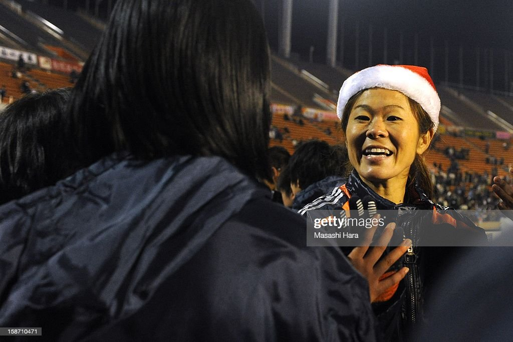Homare Sawa speaks with other players after the Great East Japan Earthquake charity match 'SAWA and Friends, X'mas Night 2012' at the National Stadium on December 25, 2012 in Tokyo, Japan.