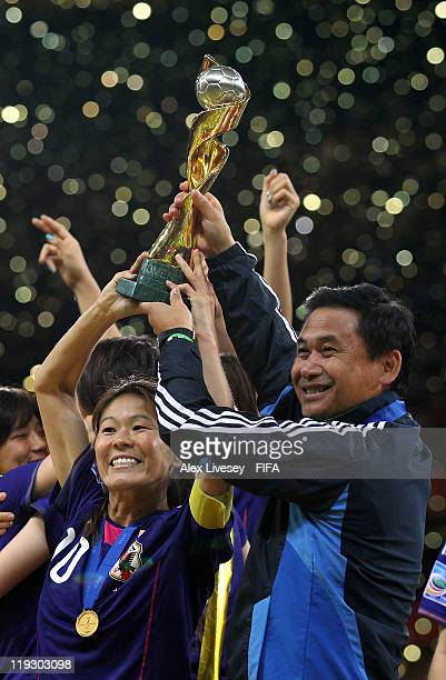 Homare Sawa the captain of Japan and Norio Sasaki the coach of Japan lift the Women's World Cup after victory over USA in the FIFA Women's World Cup...