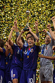 Homare Sawa the captain of Japan lifts the Women's World Cup after victory over USA in the FIFA Women's World Cup Final match between Japan and USA...