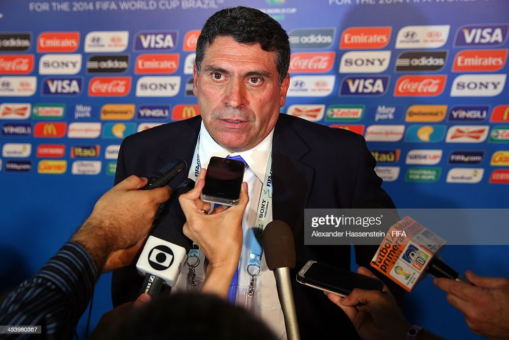 Homduras coach <a gi-track='captionPersonalityLinkClicked' href=/galleries/search?phrase=Luis+Fernando+Suarez+-+Soccer+Coach&family=editorial&specificpeople=548216 ng-click='$event.stopPropagation()'>Luis Fernando Suarez</a> speaks to members of the media after the Final Draw for the 2014 FIFA World Cup Brazil at Costa do Sauipe Resort on December 6, 2013 in Costa do Sauipe, Bahia, Brazil.