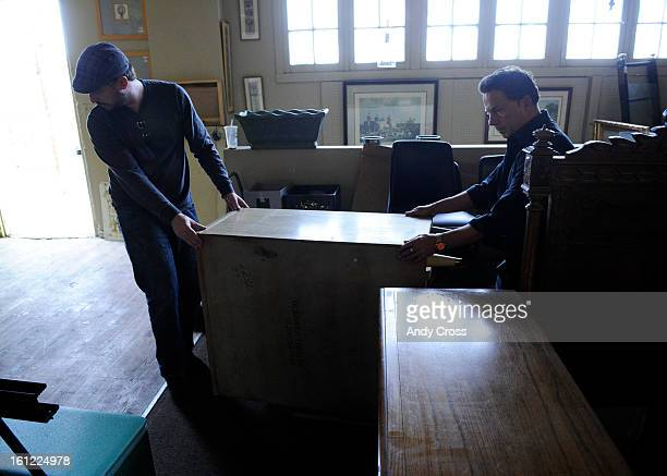 Home   Again furniture store owner  Thom Persson  right  helps customer   Scott Stone move a dresser in his store at 1959 S  Broadway  Andy Cross   The Denver. Furniture   Home Store Stock Photos and Pictures   Getty Images