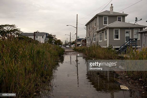 A home at the corner of B 72nd Street and Bayfield Avenue is surrounded by marsh in Averne on the Rockaway peninsula in the Queens borough of New...