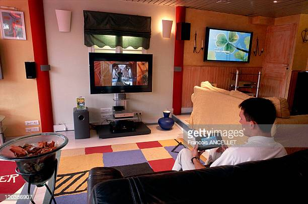 Home automation in 1999 Illustration of home automation with a home cinema and flatscreen television