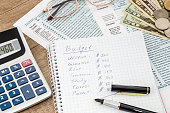 home budget with tax form, money and calculator