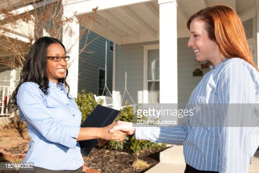 Home Buyer Shaking Hands with Realtor at Real Estate Transaction : Stock Photo