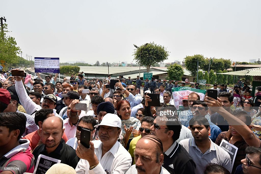 Homebuyers chant slogans against Jaypee Group Chairman and CEO Manoj Gaur as they protesting against delayed deliveries of purchased apartments outside the administrative office of Jaypee Wish Town Integrated City in Sector 128, on April 30, 2016 in Noida, India.