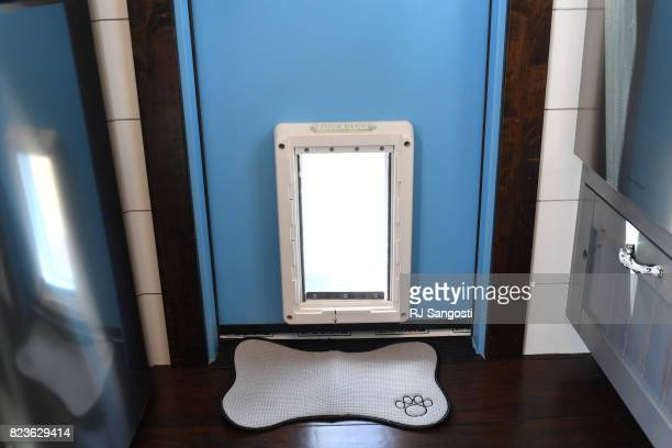 A home by Kamtz Tiny Home Company comes with a dog door at a tiny home festival at the Wild Animal Sanctuary on July 27 2017 in Keenesburg Colorado...
