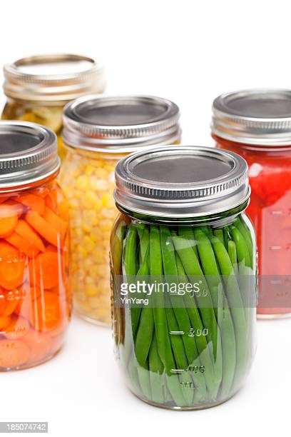 Home Canning Jars of Summer Harvest Vegetable Close-up on White