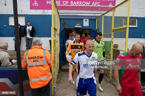 Home captain Gavin Skelton leading his team from the tunnel at Barrow AFC's Furness Building Society Stadium prior to the delayed kickoff of the...