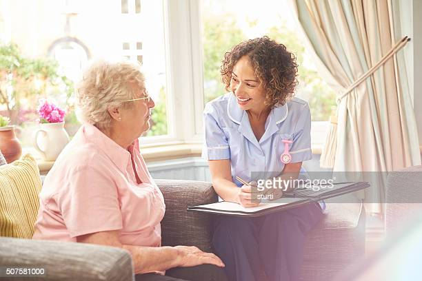 home caregiver taking notes