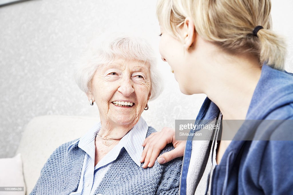 home caregiver talking with senior woman