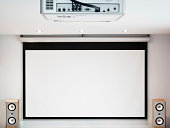 """Home cinema system. HD projector, large 102 inches screen and hifi sound system."""