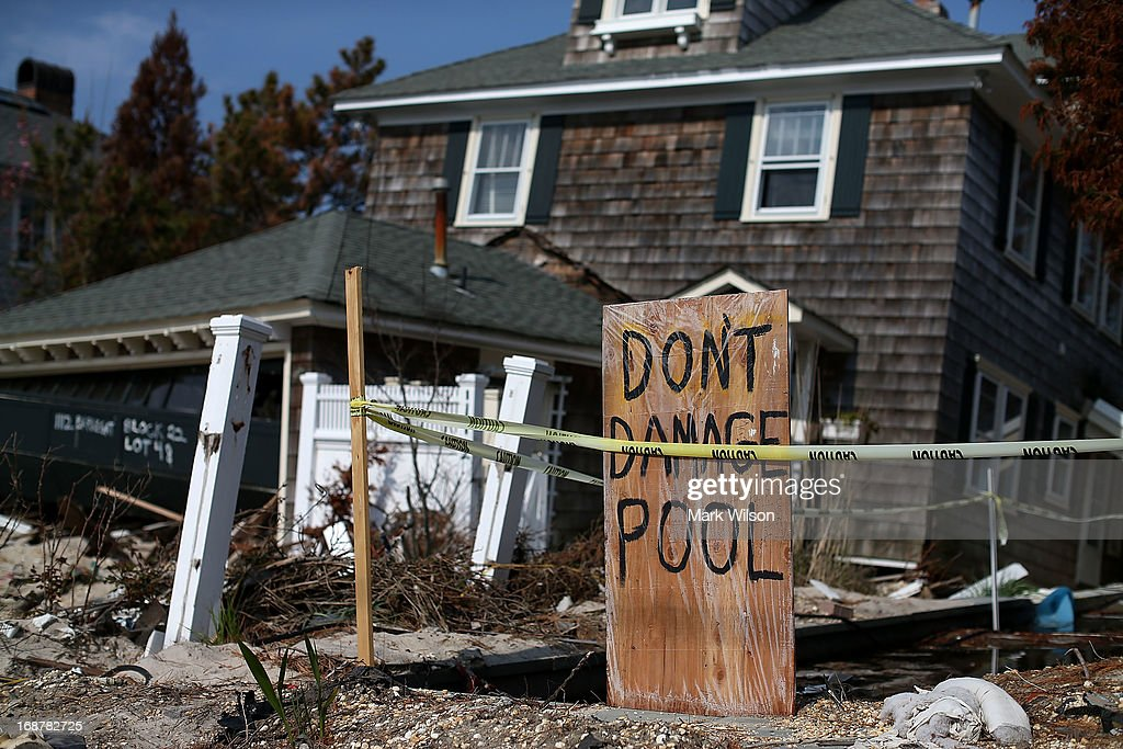 A home, damaged by Superstorm Sandy, waits to be torn down May 15, 2013 in Manotoloking, New Jersey. Mantoloking officials say that at least 50 homes are scheduled to be demolished in the up coming weeks.