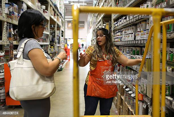 Home Depot employee Arlene Carbonell helps Anna Vasquez as she shops in the paint department at the store on August 18 2015 in Miami Florida Today...