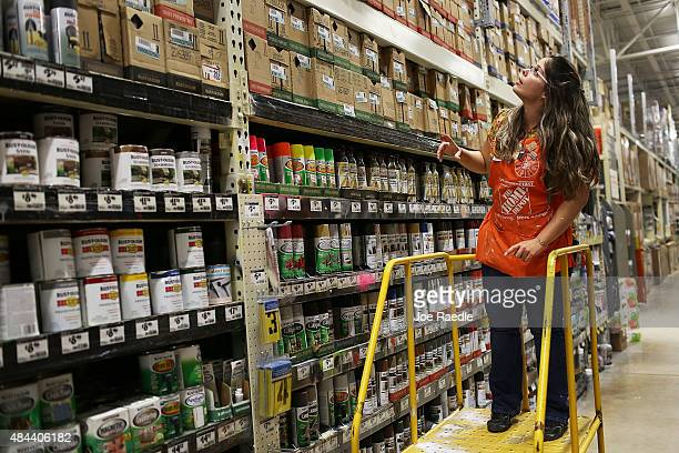 Home Depot employee Arlene Carbonell works in the paint department at the store on August 18 2015 in Miami Florida Today Home Depot shares rose as...