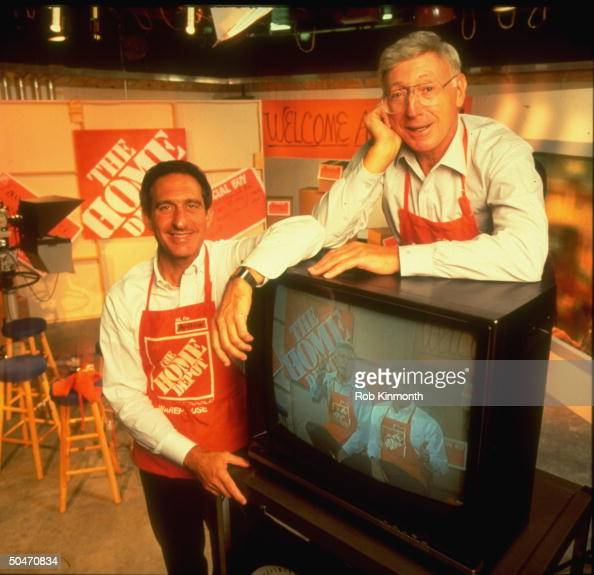 Home Depot honchos CEO Bernard Marcus Pres Arthur Blank wearing aprons posing w TV set showing them in video teaching employees how to sell in a slump