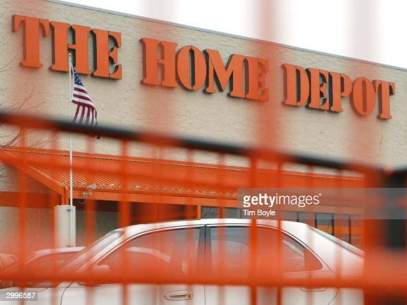 Home Depot sign is seen through one of its orange shopping carts February 19 2004 in Mount Prospect Illinois Home Depot the world's largest home...