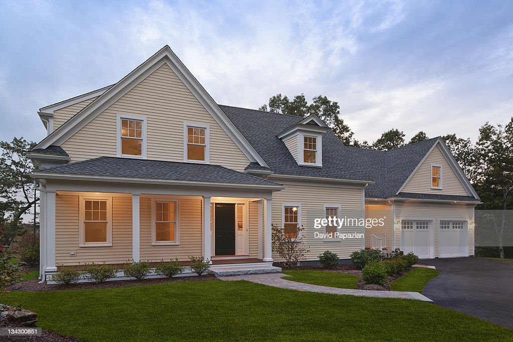 Home exterior shot at twilight. : Stock Photo